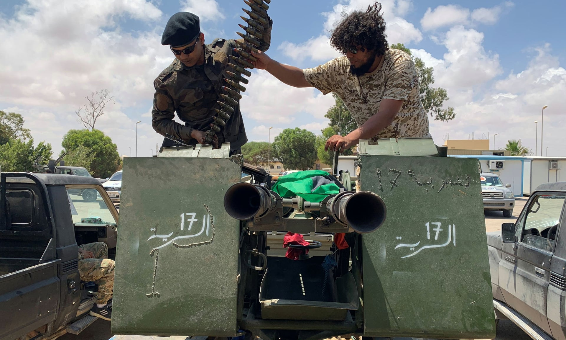 Troops loyal to Libya's internationally recognised government prepare themselves before heading to Sirte on 6 July. Photograph: Ayman Al-Sahili/Reuters